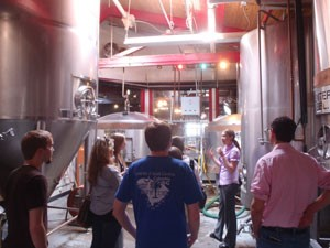 Historic Preservation students tour a former car dealership in Winston-Salem, now home to Foothills Brewery.
