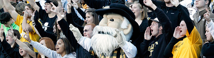football fans with Yosef the mascot