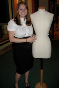 Dressing a mannequin at the Maidstone Museum and Bentliff Art Gallery in Kent, England