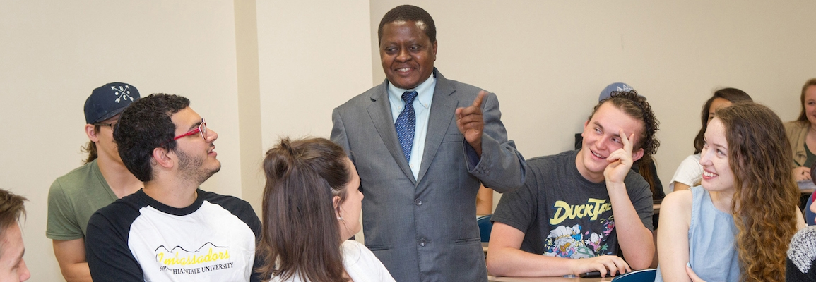 Dr. Kitunda in history classroom